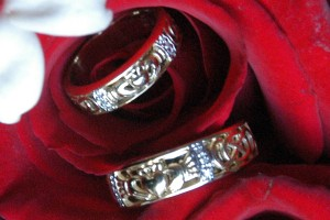[Wedding rings on bridal bouquet]